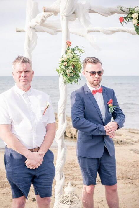 Groom waiting for bride at Crete beach wedding