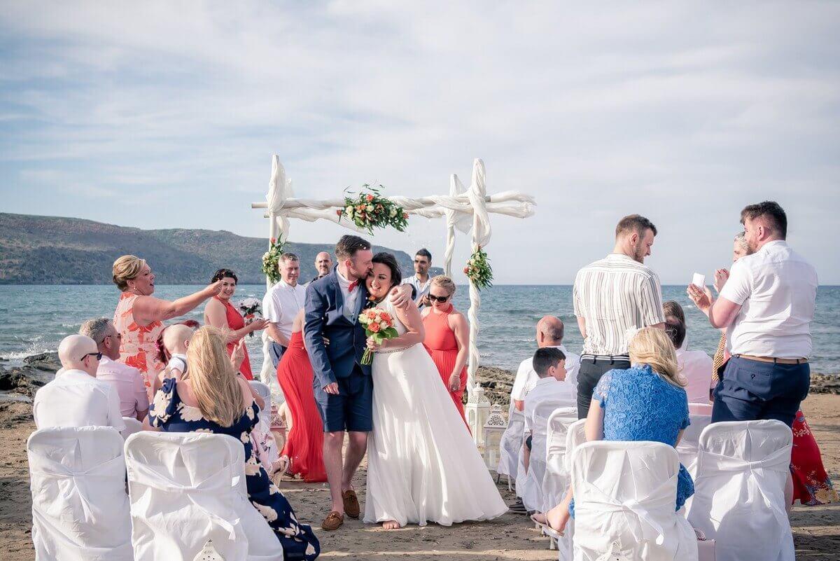 Bride and groom walk down the aisle at Crete beach wedding